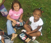 Children eating at a Malden summer food site